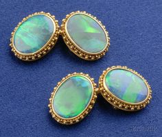 Art Nouveau 14kt Gold and Black Opal Cuff Links  Auction: 2391 Lot: 200 Sold for: $4,348