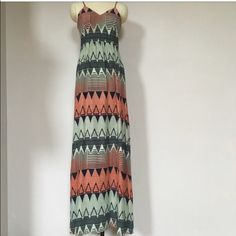Parker Niko maxi dress NWT size XS NWT! Beautiful silk maxi dress! Spaghetti straps are adjustable. Zipper closure in back. This dress is gorgeous! Pictures dont do it justice! The colors through out the dress are coral, navy, and a mint green. Size XS. Shell is 100% silk. Lining 100% polyester. No trades please. Parker Dresses Maxi