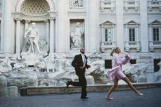 Rome, through the eyes of Vogue | Claudia Schiffer frolics in front of the Trevi Fountain.
