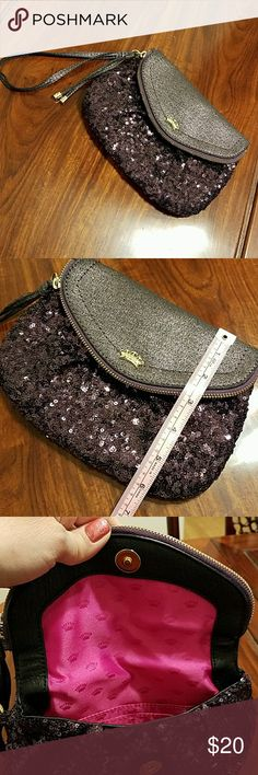 Juicy Couture Purple Sparkle Clutch Beautiful and fun bag. Purple Sequins, and gold accents. Used a couple times. No Damage. Only imperfection is wrist strap has one little crinkle from where it was held, but barely noticeable. Bag has 1 zipper pouch inside purse, as well as places to slip your cards into. Bag closes with magnetic snap. Flap of bag has zipper that opens up and you can stuff alot of stuff in there as well. Juicy Couture Bags