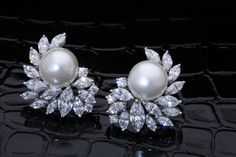 Add subtle #beauty to an #elegant, #everyday #outfit with this exquisite pair of #DiosabyDarshanDave #earrings. Gracefully combining white Korean #pearls with #SwarovskiZirconia, they are perfect for #dailywear and #travel. Available on www.diosajewels.com #makeeverydaybrilliant #jewellery #finejewellery #traveljewellery #weddings #fashionwear #preciousjewellery #luxejewellery  #dailywear #workwear #casualwear #destinationweddings #bridalwear
