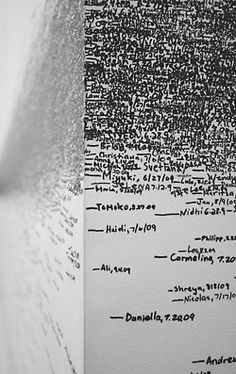Roman Ondak / Measuring the Universe / 2007    Over the course of the four-month exhibit, attendants marked visitors' first names, height measurements, and the date on which they were recorded. Beginning as an empty white space, over time the gallery accumulated the traces of thousands of visitors.