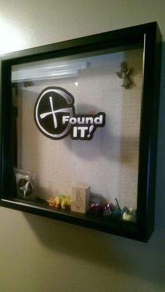 Geocaching display case. Wanted a cool place to store all the trinkets we find while geocaching. Foind a $7 shadow box at walmart, ordered a cool geocaching vinyl from amazon and now we can display our cach with pride. :)