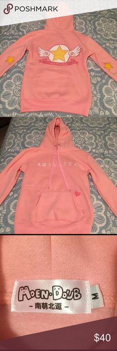 Cardcaptor Sakura Pink Sweatshirt Medium Brand new, unworn pink Cardcaptor Sakura pullover sweatshirt. Imported. Size medium. Absolutely adorable! Comes from a smoke free home. moen doub Tops Sweatshirts & Hoodies