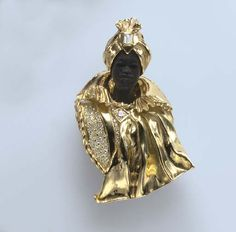 A HARDSTONE, GOLD AND DIAMOND BLACKAMOOR BROOCH  The carved hardstone blackamoor wearing a sculpted and polished gold turban, enhanced by a rectangular-cut diamond, and a gold tunic of similar design, with circular-cut diamond detail, mounted in 18k gold