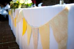 DIY banners in different fabrics of wedding colors. Love.