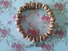 Bracelet with wooden beads and coconut wooden spacers. With Greyhound charm.
