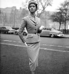 Model in tailored checked suit by Simon Massey, photo by Chaloner Woods, London, 1953