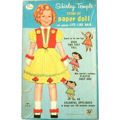 Shirley Temple is a stand-up vintage 1950 paper doll with life like hair, plastic snap-ons, and an easel back. She has 40 colorful appliques, The 10
