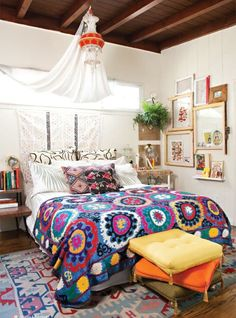 Bohemian style bedroom with suzani pattern blanket and kilim rugs