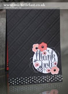 The Stylish Stripes embossing folder was stamped in 2 directions to create this plaid/checked pattern. Black makes a great background for these small peach flowers. DIY thank you card.
