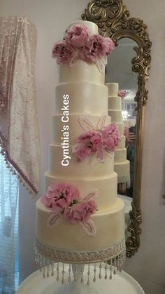7 tiers of pure joy. This wedding cake is adorned with ranaculous from Japan.  By Cynthia's Cakes in Edinburg tx.  www.cynthiascakesllc.com