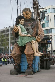 French street theatre company Royal De Luxe performing Sea Odyssey, a story based on the Titanic. Uncle puppet is 50 feet high...