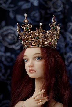 Commission crown in cast bronze with emeralds, garnets, and freshwater pearls, by Mai Mckemy.  Modeled on a Popovy doll.
