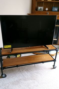 Diy rolling industrial pipe tv stand entertainment center with diy tv decor Industrial Tv Stand, Industrial Pipe, Industrial House, Industrial Furniture, Industrial Design, Tv Stand And Entertainment Center, Entertainment Room, Layout, Tv Stand Plans