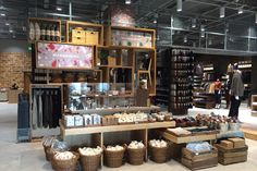 The Muji store occupies a unit at the Hollywood Galaxy Shopping Center and features an austere warehouse-like interior. The many offerings are presented by way of wooden shelving and displays, adding a softer, welcoming touch to the retail space.