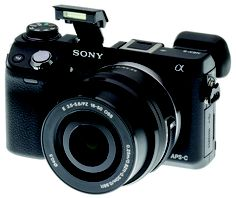 Sony Alpha NEX-6 Compact 16.1MP  Interchangeable Lens Digital Camera .. This is going to be nice to have during concert or documentary shooting. Very versatile and capable.