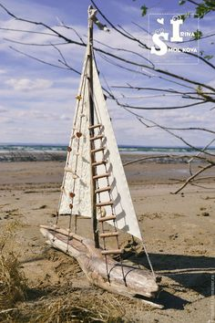 Buy or order the big boat in online shops on My Livemaster. A large ship, whose base is made of polished by time and water driftwood. Sails are sewn of cotton, the inscription is transferred to the cloth, the numbers are stamped. The stairs are made by hand from chopped branches. Decorated with seashells, wooden hearts, delicate cotton lace and button . Wood well dried. The label may be any, it is possible to apply a memorable date, a name, logo, etc.