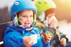Happy little skiers resting, drinking tea and eating cookies royalty-free stock photo