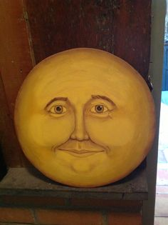 Hand painted moon face. Lois Croce