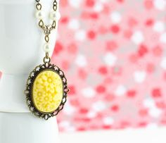 Yellow Floral Cameo Necklace, Brass Necklace, Ivory Pearls. $28.00, via Etsy.
