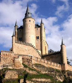 """Alcázar de Segovia (Siglo XII) An """"alcázar"""" is a type of castle in Spain built by kings to live in. The term derives from the Arabic word القصر (trans. al-qasr) meaning """"fort, castle or palace"""" while the Arabic word is possibly in turn derived from the Latin word 'castrum', meaning an army camp or fort. Many cities in Spain have an alcázar; Spain also has Moorish citadels known as """"Alcazabas""""."""