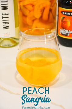 Peach Sangria is a crisp white wine sangria made with frozen peaches, peach schnapps, and vodka mixed with a bottle of wine. Sangria Vodka Recipe, Peach Schnapps Drinks, Peach Sangria Recipes, Batch Cocktail Recipe, Peach Drinks, Fruity Drinks, Cocktail Recipes, Drink Recipes, Triple Sec