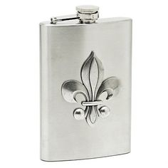 "Fleur de Lis Hip Flask by HomeWetBar. $28.95. Fleur de Lis Hip Flask measures 6""x3¾"", holds 8oz. Crafted from brushed stainless steel and featuring a three-dimensional genuine pewter Fleur de Lis. A hip flask that celebrates royal refinement and pleasant practicality. Our regal hip flask allow your spirits a bit of luxury. A hip flask that celebrates royal refinement and pleasant practicality. Our regal hip flask allow your spirits a bit of luxury. Crafted fro..."
