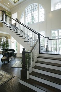 in love with lots of windows and grand staircases that are more like art than just stairs in my dream house with black and white checkerboard marble instead of wood Foyer Staircase, Staircase Design, Staircase Ideas, Staircase Pictures, Staircase Decoration, Luxury Staircase, Spiral Staircases, Grande Cage D'escalier, Lots Of Windows