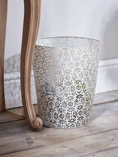 Made from lightweight iron, our aged metal cream bin has a rustic distressed finish and detailed filigree cut out pattern. A stylish alternative to traditional bins, use as a wastepaper basket in your dressing room or bedroom.