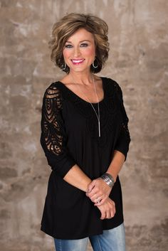 The Suzanne Top will be your go to favorite! Round neckline, 3/4 dolman style sleeve and slight hi-lo hem. The front and back bodice and shoulders are adorned with a beautiful lace overlay.