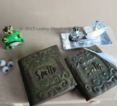 Spell books for a dollhouse made with faux leather covers from craft foam and polymer clay.
