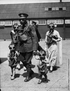 Like a trip to the zoo   A soldier escorts two young visitors to the gas chambers during an open day at Kingston Barracks in Surrey. (Photo by Keystone/Getty Images). 29th June 1935
