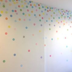 121 fun pastel multi-color dot confetti adhesive fabric wall decals that are removable and reusable wall stickers. Our polka dot wall decals add a beautiful soft rainbow of colors to your walls! This is a lighter and softer version of our confetti rainbow dots with a slight satin sheet.