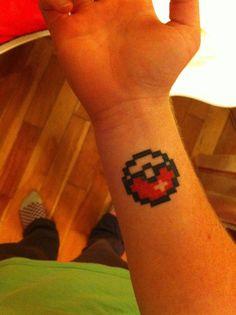 8-bit Pokéball tattoo, artist unknown.