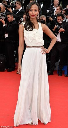 Pleated princess: Zoe Saldana wore a white dress by Victoria Beckham featuring a pleated detail skit and a gold chain belt which accentuated her tiny waist