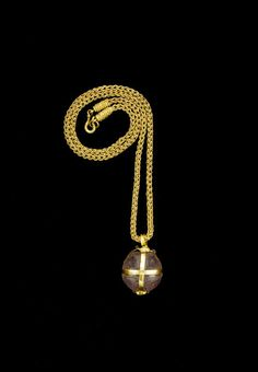 A Migration period gold mounted amethyst ball pendant necklace. Circa 5th-7th Centuries A.D.