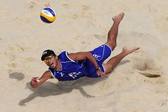 Laying out Katsuhiro Shiratori of Japan dives for a shot during the Men's Beach Volleyball preliminary match against Spain .