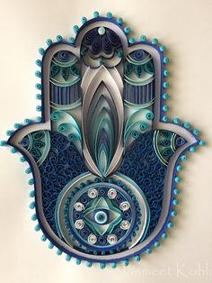This beautiful and unique HAMSA artwork is made by glueing 1/4 inch card stock paper strips to card stock paper in a design. The artwork is about 8x10 and comes matted in a 11x14 color white mat. Its ready to be framed in 11x14 shadow box frame or a deep frame. This decorative piece uses