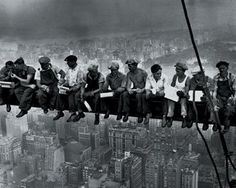 """Charles C. Ebbets: """"Lunchtime atop a Skyscraper"""" -- made during the construction of the GE Building in the Rockefeller Center on 29 September 1932. It was published on 2 October in the New York Herald Tribune."""