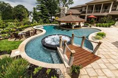 This freeform pool features a firepit, swim-up bar, and a bridge that leads right to the bubbling custom spa. Gold winner, NESPA; Crystal Pool & Spa, Inc., East Hanover, New Jersey http://www.poolspaoutdoor.com/photos/2013-nespa-award-winning-pools.aspx