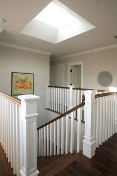 Adding a skylight above a staircase will bring natural light to many parts of the house. White Banister, Banister Remodel, Family Room, Home And Family, Family Homes, Traditional Staircase, Stair Railing, Banisters, Railings
