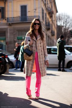 Bright pink pants, plaid peacoat and a petite neutral Chanel.