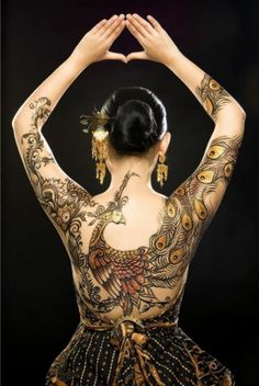 Traditional Javanese Henna peacock tattoo.  http://blog.tattoodo.com/2014/04/40-enticing-peacock-tattoos/