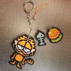 Garfield keychain perler beads by dzsisshop: Melty Bead Patterns, Hama Beads Patterns, Beading Patterns, Perler Beads, Fuse Beads, Hama Bead Boards, Perler Bead Templates, Pixel Pattern, Iron Beads