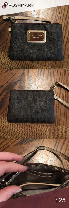 Michael Kors small wristlet! Small gently used Michael Kors wristlet! Has 2 credit card slots and a small pocket on the inside. Michael Kors Bags Wallets