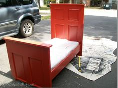 Toddler Bed made from an old door.  Looks as good as any I've seen for high $.