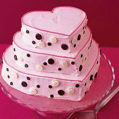 Chocolate cakes are cut into different sized hearts to make this towering dessert.