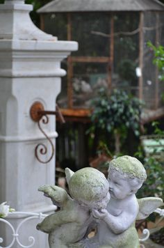 cherubs! garden inspiration. Tina of The Enchanted Home sells these on her website.