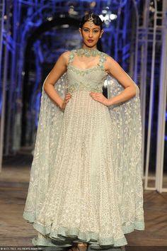 Miss India 2013 Navneet Kaur Dhillon walks the ramp for designer Tarun Tahiliani during the Grand Finale of the India Bridal Fashion Week (IBFW) 2013, held in New Delhi.